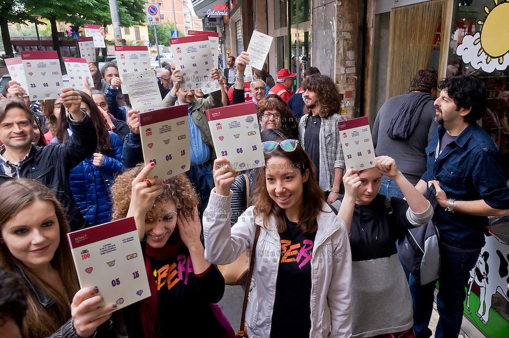 Roma 23 Maggio 2015<br /> La Campagna Slotmob contro la diffusione del gioco d'azzardo legalizzato a organizzata una marcia nel quartiere Tiburtino consegnando degli adesivi ai bar slot-free che hanno rinunciato agli introiti dell'azzardo per un puro gesto di responsabilità, e che sono stati premiati, con una colazione di massa,  dei partecipanti alla marcia.<br /> Rome May 23, 2015<br /> Campaign Slotmob against the spread of legalized gambling in a march organized in the district Tiburtino delivering stickers to bar slot-free that they gave up to the revenue of chance for a pure gesture of responsibility  and have been rewarded with a Breakfast mass of marchers.