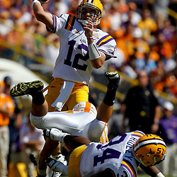 Oct 2, 2010; Baton Rouge, LA, USA; LSU Tigers quarterback Jarrett Lee (12) throws a pass against the Tennessee Volunteers during the first quarter at Tiger Stadium. LSU defeated Tennessee 16-14.  Mandatory Credit: Derick E. Hingle