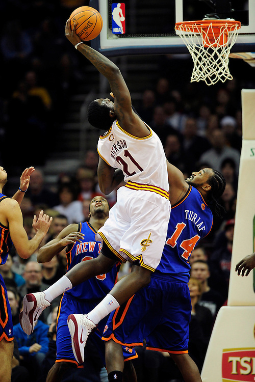 Feb. 25, 2011; Cleveland, OH, USA; Cleveland Cavaliers power forward J.J. Hickson (21) grabs a rebound over New York Knicks center Ronny Turiaf (14) during the first quarter at Quicken Loans Arena. Mandatory Credit: Jason Miller-US PRESSWIRE