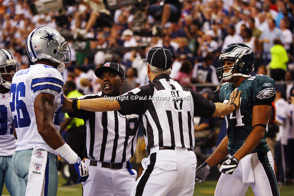IRVING, TX - SEPTEMBER 15:  Safety Ken Hamlin #26 of the Dallas Cowboys and wide receiver Hank Baskett #84 of the Philadelphia Eagles are separated by back judge Bob Lawing #17 and side judge Michael Banks #72 at Texas Stadium on September 15, 2008 in Irving, Texas. The Cowboys defeated the Eagles 41-37. ©Paul Anthony Spinelli *** Local Caption *** Ken Hamlin;Hank Baskett;Bob Lawing;Michael Banks