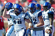 DALLAS, TX - OCTOBER 25:  Alan Cross #40 of the Memphis Tigers celebrates after rushing for a 1 yard touchdown against the SMU Mustangs during the 2nd quarter on October 25, 2014 at Gerald J. Ford Stadium in Dallas, Texas.  (Photo by Cooper Neill/Getty Images) *** Local Caption *** Alan Cross