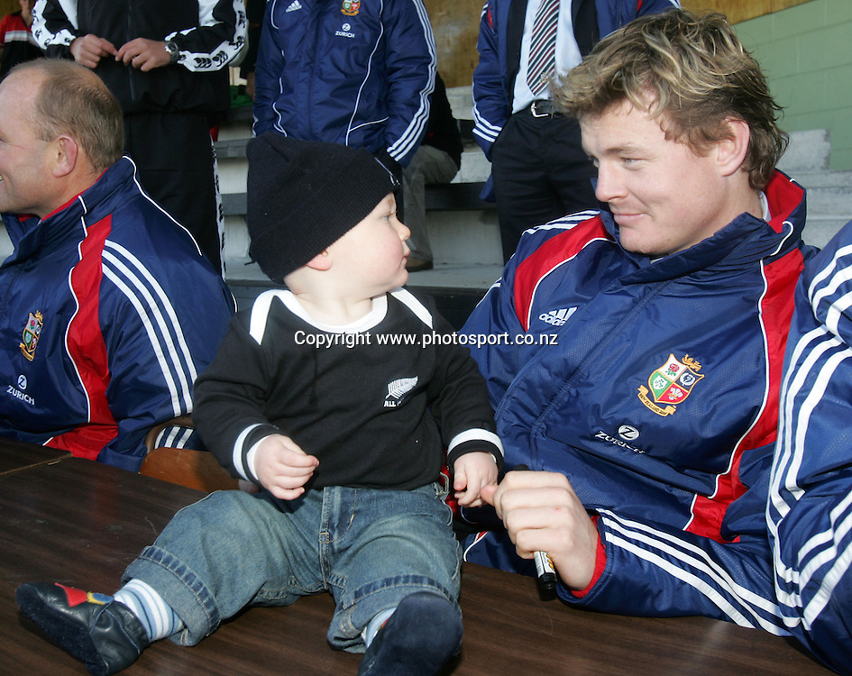 Lions captain Brian O'Driscoll with 10 month old William Hodge at Victoria Park, Stratford, New Plymouth, New Zealand on Wednesday 8 June, 2005. The Lions play Taranaki tonight. Photo: Hannah Johnston/PHOTOSPORT