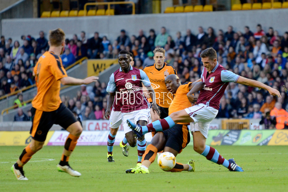 Benik Afobe challenges Ciaran Clark during the Pre-Season Friendly match between Wolverhampton Wanderers and Aston Villa at Molineux, Wolverhampton, England on 28 July 2015. Photo by Alan Franklin.