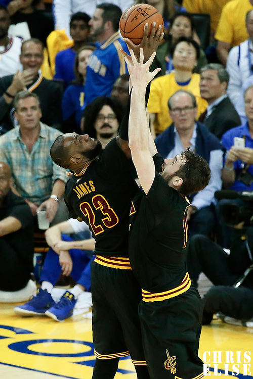12 June 2017: Cleveland Cavaliers forward LeBron James (23) vies for the rebound with Cleveland Cavaliers forward Kevin Love (0) during the Golden State Warriors 129-120 victory over the Cleveland Cavaliers, in game 5 of the 2017 NBA Finals, at the Oracle Arena, Oakland, California, USA.