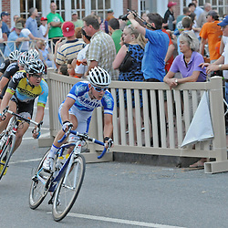 Joseph Schmalz, of Elbowz Racing who won the Pro Men's Iron Hill Twilight Criterium is seen here rounding the corner at Church and Market Streets. TK4