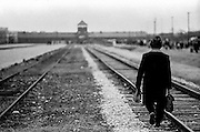 A survivor of the Auschwitz (Birkenau) Nazi concentration camp is walking the railway track after the ceremony to remember the 50th anniversary of the liberation in 1995. It is estimated that between 1.1 and 1.5 million Jews, Poles, Roma and others were killed here in the Holocaust between 1940-1945.