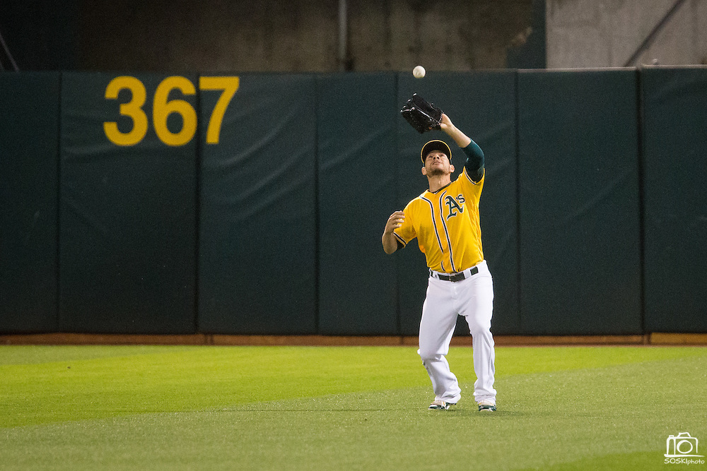 Oakland Athletics third baseman Danny Valencia (26) catches a popup from Baltimore Orioles first baseman Chris Davis (19) in the eighth inning at Oakland Coliseum in Oakland, Calif. on August 8, 2016. (Stan Olszewski/Special to S.F. Examiner)