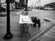 04 APRIL 2019 - CARROLL, IOWA:  A table on the sidewalk in Carroll, IA. Beto O'Rourke stopped at Kerps Tavern in Carroll, IA, to campaign for president Thursday. He is crisscrossing Iowa through the weekend with stops throughout the state. Iowa holds its caucuses, considered the kickoff of the US Presidential campaign, on Feb. 3, 2020.    PHOTO BY JACK KURTZ