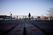 A man crosses the Union Street Bridge over the Gowanus Canal, Brooklyn.