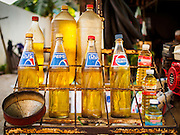 27 FEBRUARY 2015 - PHNOM PENH, CAMBODIA: A stand selling gasoline out of recycled soft drink bottles in Phnom Penh. The gas is usually bought by motorcycle and tuk-tuk drivers.    PHOTO BY JACK KURTZ