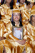 Victoria Hargrove holds a photo of Jamycol Harris during the Thurgood Marshall High School commencement at the Dayton Masonic Center, Tuesday, May 24, 2011.