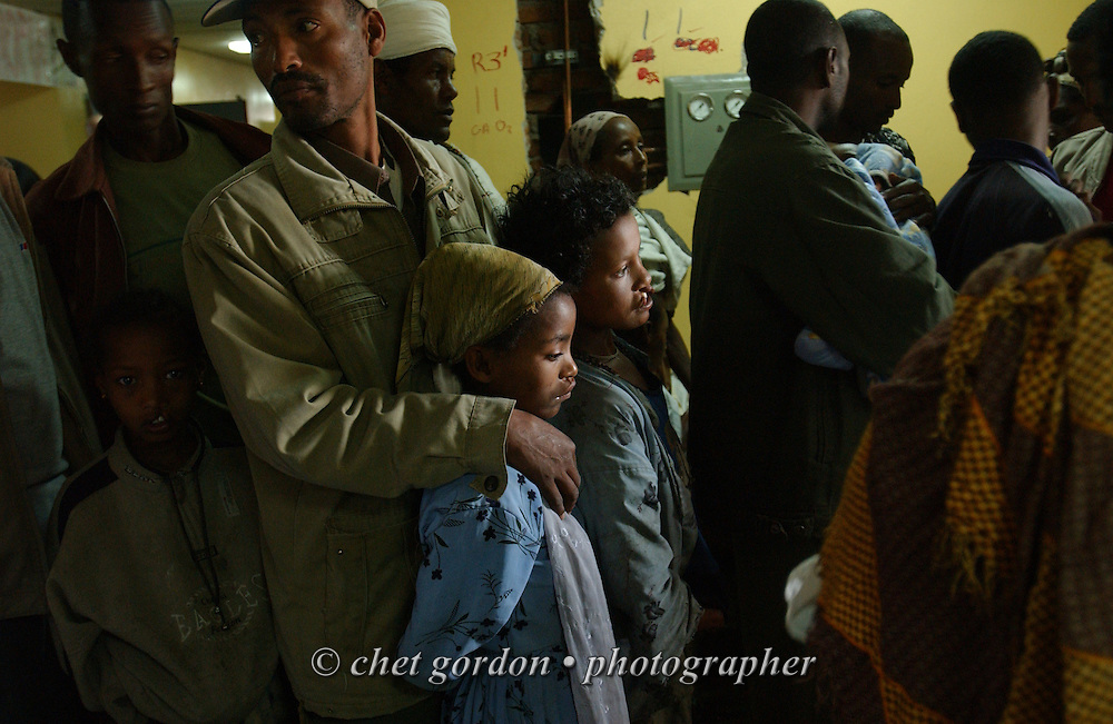 Ethiopian parents wait with their children to see a pediatrician in the pre-operative ward at the Black Lion Hospital in Addis Ababa, Ethiopia on Wednesday, December 7, 2005. An international volunteer medical team with Operation Smile were in Ethiopia's capital city volunteering their time during Operation Smile's inaugural mission to Ethiopia. Operation Smile is the Norfolk, VA based medical organization that provides free facial reconstructive surgery to children and young adults in 24 countries.