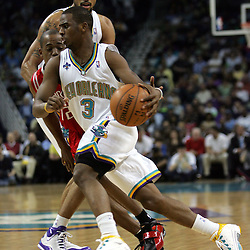 New Orleans Hornets guard Chris Paul drives past Houston Rockets guard Rafer Alston #12 in the third quarter of their NBA game on March 19, 2008 at the New Orleans Arena in New Orleans, Louisiana. The New Orleans Hornets claimed first place in the Western Conference with a 90-69 victory over the Houston Rockets.