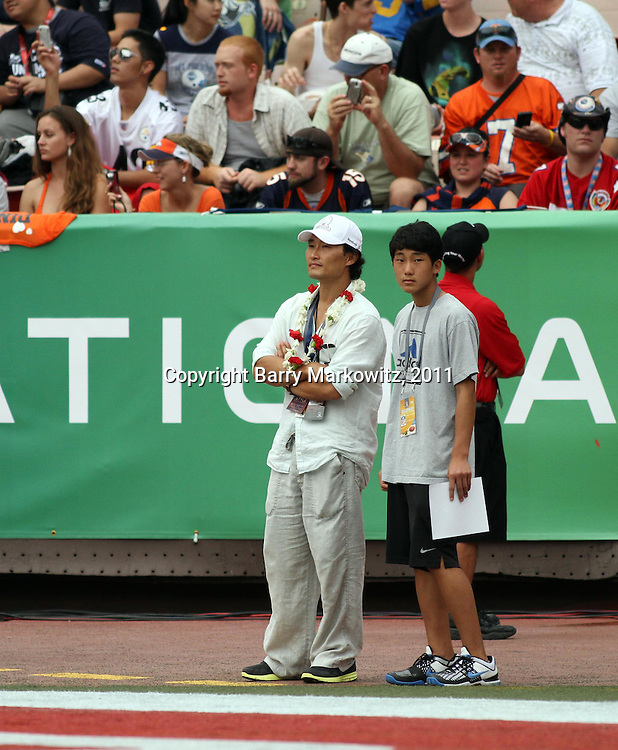 Hawaii Five-0 star, Daniel Dae Kim enjoys a day out with his son at the NFL Pro Bowl, Aloha Stadium, 1/30/11, Photo by Barry Markowitz