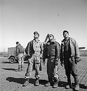 "These stunning photos of the Tuskegee Airmen show cool dedication in the face of wartime segregation<br /> <br /> The Tuskegee Airmen were determined men who volunteered to be America's first Black military airmen and were trained as pilots, navigators, & bombardiers.<br /> <br /> Photographer Toni Frissell captured these men with a mission<br /> <br /> By the time World War II broke out, African Americans had already been pressing for access to elite military training for decades. They knew the U.S. government was not keen on integrating its military—a stance so pervasive that one black pilot even enlisted in the French air service after being rejected by his own. But the interwar period saw civil rights groups and professional organizations like the NAACP pressing for greater access to military training, and in 1939 they were rewarded when a House Appropriations Bill earmarked funds for training African American pilots at any civilian flight schools that would have them. The historically black university in Tuskegee, Alabama, had such a program. Its graduates would come to form an elite squadron of all-black military pilots, known colloquially as the ""Tuskegee Airmen,"" officially the 332nd Fighter and the 477th Bombardment groups. <br /> <br /> In April 1943 the airmen shipped out to North Africa and Sicily, where they promptly garnered distinction for their effectiveness in clearing Axis forces from strategic Mediterranean naval routes. Soon the 332nd was escorting bomber missions into central Europe and Germany, shooting down the Luftwaffe's technologically superior fighter jets and earning the nickname ""Red-Tail Angels"" for their aircrafts' custom crimson-dipped nose and tail paint jobs.<br /> <br /> Antoinette ""Toni"" Frissell was a Manhattan fashion photographer who volunteered for war in 1941 and became an official chronicler of the American Red Cross and Women's Army Corps activities in Europe, producing inspirational images for use as propaganda. To that extent her pictures from the war are persu"