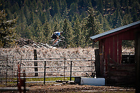 JEROME A. POLLOS/Press..A cyclist pedals past a barn on the Centennial Trail in Post Falls in the sunny, 63-degree weather Monday.