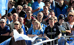 Manchester City fans await the trophy parade in Manchester.