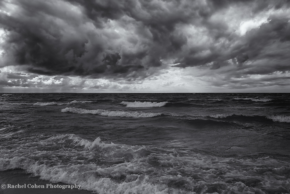 &quot;As the World Turns&quot; mono<br /> <br /> Beautiful tumultuous image from Lake Michigan during an autumn storm. dark skies churning, and waves crashing!!<br /> <br /> Black and White Images by Rachel Cohen