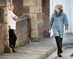 © Licensed to London News Pictures. 04/03/2019. Salisbury, UK. Prime Minister Theresa May (R) talks with residents during a visit to Salisbury on the first anniversary of the poisoning of former Russian spy Sergei Skripal and his daughter Yulia in March 2018. They both survived the nerve agent attack but a resident of nearby Amesbury, Dawn Sturgess, died in June 2018 after coming in contact with the poison. Two Russians have been named in connection with the attack. Photo credit: Peter Macdiarmid/LNP