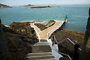 Rosaire Steps ferry dock at low tide, Island of Herm, Channel Islands, Great Britain