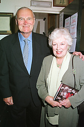 Actress JUNE WHITFIELD and her husband MR TIM AITCHISON, at a party in London on 12th September 2000.OGU 73