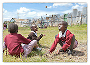 NGO Photography Workshop in the Lenana Slum of Nairobi, Kenya.Photo ©Suzi Altman In 2014, Suzi Altman traveled to Kenya at the invitation of The Supply, an NGO that operates a school in the Lenana slum, near Nairobi.<br />