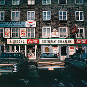 Lower Town of Quebec City circa 1960. This image is part of a series Don Newlands photographed documenting life in Quebec. Newlands observed the families living in poverty, political unrest and uprising of the Separatist Movement.