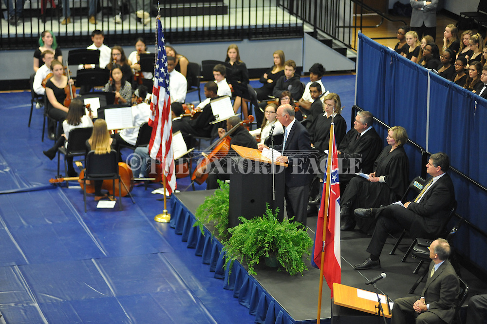 Charles Overby, chairman and CEO emeritus of the Freedom Forum, speaks during a Naturalization Ceremony in U.S. District Court for the Northern District of Mississippi, at Oxford High School in Oxford, Miss. on Tuesday, November 18, 2014. The ceremony was the first the court has ever held at the school.