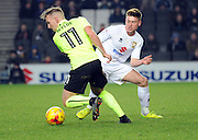 Gregg Wylde of Northampton Town and Robbie Muirhead of MK Dons (18) during the EFL Sky Bet League 1 match between Milton Keynes Dons and Northampton Town at stadium:mk, Milton Keynes, England on 21 January 2017. Photo by Andy Handley.
