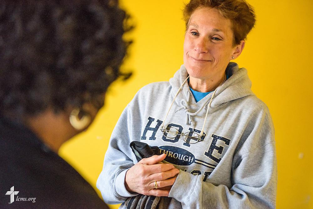 Liz Garlington listens to Bernice Cromartie, owner of Nanny's Korner Care Center, on Thursday, Jan. 19, 2017, in Lumberton, N.C. The center was damaged in October from flooding related to Hurricane Matthew. LCMS Communications/Erik M. Lunsford