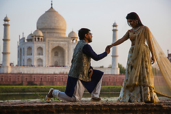 Marriage proposal in front of the Taj Mahal, Agra, India,