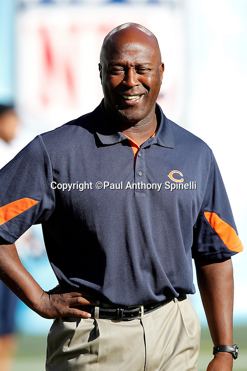Chicago Bears Head Coach Lovie Smith smiles as he watches pregame warmups during a NFL week 1 preseason football game against the San Diego Chargers, Saturday, August 14, 2010 in San Diego, California. The Chargers won the game 25-10. (©Paul Anthony Spinelli)