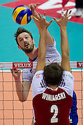 (L) Julien Lyneel from France attacks against (R) Jakub Winiarski from Poland during the 2013 CEV VELUX Volleyball European Championship match between Poland and France at Ergo Arena in Gdansk on September 21, 2013.<br /> <br /> Poland, Gdansk, September 21, 2013<br /> <br /> Picture also available in RAW (NEF) or TIFF format on special request.<br /> <br /> For editorial use only. Any commercial or promotional use requires permission.<br /> <br /> Mandatory credit:<br /> Photo by &copy; Adam Nurkiewicz / Mediasport
