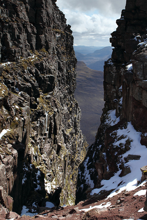 View down into the chasm of the Black Notch of Sgurr Mor, one of the munro peaks of Beinn Alligin, near Torridon in the north-west Highlands of Scotland