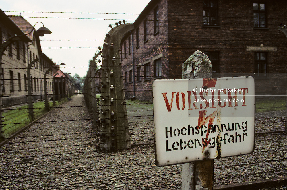 A chilling sign warning of death next to barbed wire in Auschwitz I (O?õwi?ôcim) concentration camp, Poland.