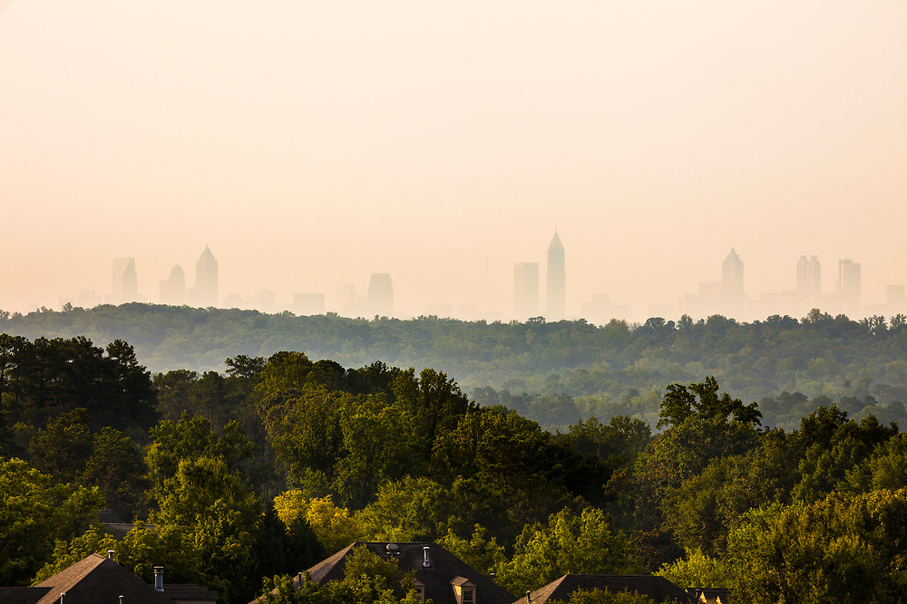 Vinings Neighborhood with downtown skyline in the back, Atlanta, Georgia, USA<br /> <br /> For LICENSING and DOWNLOADING this image follow this link: http://www.masterfile.com/em/search/?keyword=600-06196592&amp;affiliate_id=01242CH84GH28J12OOY4<br /> <br /> For BUYING A PRINT of this image press the ADD TO CART button.<br /> <br /> Download of this image is not available at this site, please follow the link above.