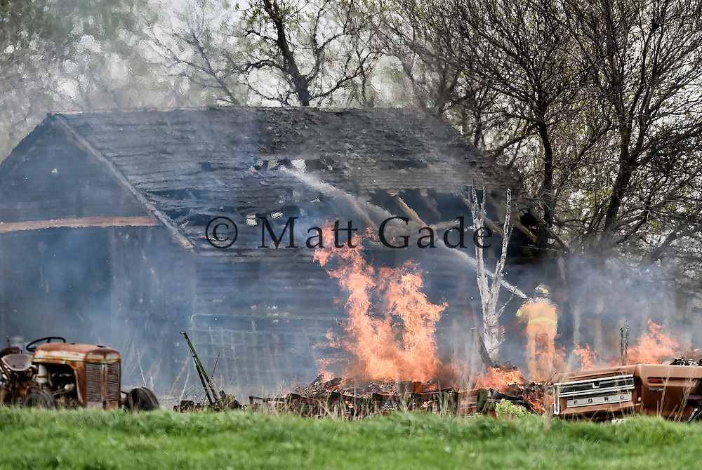 Members of the Ethan fire department respond to a structure fire where the fire from a controlled burn spread to a barn on Tuesday afternoon a half mile east of Ethan. (Matt Gade/Republic)