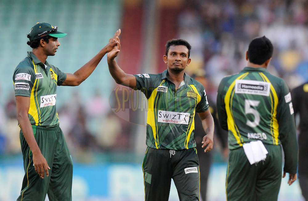 Ishan Jayaratne of Southern Express celebrates the wicket of Mohammad Hafeez Captain of Lahore Lions during the qualifier 5 match of the Oppo Champions League Twenty20 between the Southern Express and the Lahore Lions held at the Chhattisgarh International Cricket Stadium, Raipur, India on the 16th September 2014<br /> <br /> Photo by:  Pal Pillai / Sportzpics/ CLT20<br /> <br /> <br /> Image use is subject to the terms and conditions as laid out by the BCCI/ CLT20.  The terms and conditions can be downloaded here:<br /> <br /> http://sportzpics.photoshelter.com/gallery/CLT20-Image-Terms-and-Conditions-2014/G0000IfNJn535VPU/C0000QhhKadWcjYs