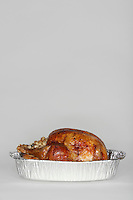 Roasted turkey in tinfoil pan