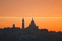 Paris, view across rooftops to Sacre Coeur and Montmartre just before dawn.