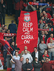 LIVERPOOL, ENGLAND - Sunday, May 19, 2013: Liverpool supporters on the Spion Kop with a banner for Jamie Carragher 'Keep Calm And Carra On' before the final Premiership match of the 2012/13 season against Queens Park Rangers at Anfield. (Pic by David Rawcliffe/Propaganda)