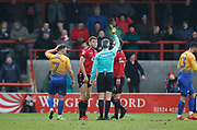Morecambe's Sam Lavelle(16) is shown a yellow card  by Referee Sebastian Stockbridge during the EFL Sky Bet League 2 match between Morecambe and Mansfield Town at the Globe Arena, Morecambe, England on 27 January 2018. Photo by Paul Thompson.