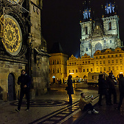 "A man taking a ""selfie"" in front of the famous atomic clock in the Old Town Square of Prague, capital of the Czech Republic, on 10 November 2014."