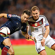 Scotland's Russell Martin (L) and Mario Gotze (R) in action. UEFA EURO 2016 European Championship qualifying round. Scotland v Germany. Hampden Park, Glasgow, Britain.  Final score Scotland 2 Germany 3.  07 Sept 2015