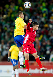 Felipe Melo of Brazil vs Pak Nam Chol of North Korea during the 2010 FIFA World Cup South Africa Group G match between Brazil and North Korea at Ellis Park Stadium on June 15, 2010 in Johannesburg, South Africa. Brazil defeated Korea 2-1. (Photo by Vid Ponikvar / Sportida)