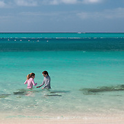 Sisters playing in Grace Bay at Providenciales, Turks and Caicos
