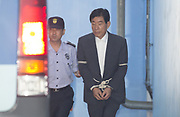 Won Sei-hoon (R), former chief of the National Intelligence Agency (NIS) walks to get on a bus heading to a prison, at a court compound in Seoul, South Korea, Aug 30, 2017. The Seoul High Court on Wednesday sentenced Won to four years in prison, finding him guilty of meddling in the 2012 presidential election of South Korea through a covert cyber operation, local media reported. The former spy agency chief Won Sei-hoon led the NIS from 2009 to 2013 and he is the close confidant of former South Korean President Lee Myung-bak. Photo by Lee Jae-Won (SOUTH KOREA) www.leejaewonpix.com