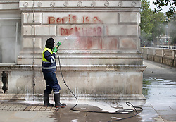 © Licensed to London News Pictures. 07/06/2020. London, UK. The words 'Boris is a dickhead' are cleaned from the walls of The Foreign Office in Whitehall after yesterday's Black Lives Matter protest march . New quarantine rules on passengers entering the United Kingsom come into force tomorrow. People entering the country will have to quarantine for two weeks. Photo credit: Peter Macdiarmid/LNP