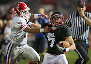 Linn-Mar's Matt Meier (7) tries to hold off Washington's Charles Blades (7) after a reception during the first quarter of the game between Cedar Rapids Washington and Linn-Mar at Linn-Mar Stadium in Marion on Friday, September 14, 2012.