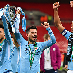 Ilkay Gundogan of Manchester City celebrates with Leroy Sane and Vincent Kompany